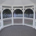 10 by 14 foot wooden oval gazebo with wooden flooring