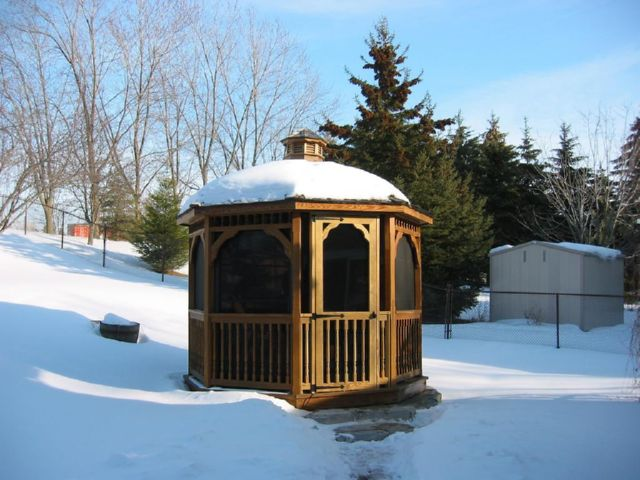 10 foot wooden octagon gazebo covered in snow
